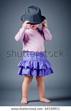little funny girl in hat - stock photo