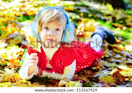 little  funny girl meeting autumn  - stock photo
