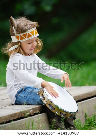 little funny girl playing native american - stock photo