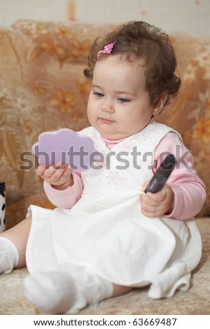 little funny girl with mirror - stock photo