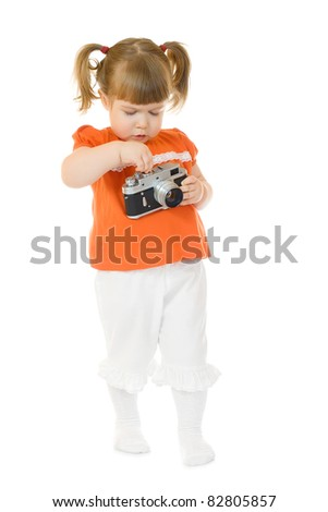 Little funny girl with photo camera isolated - stock photo