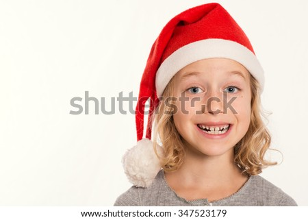 little funny girl with Santa- Claus cap