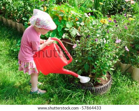 Little gardener with a bailer - stock photo
