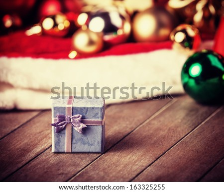 Little gift at christmas background - stock photo