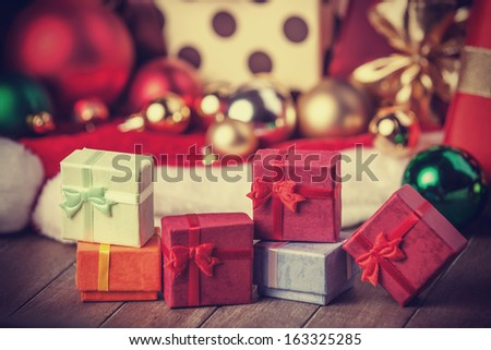 Little gifts at christmas background - stock photo