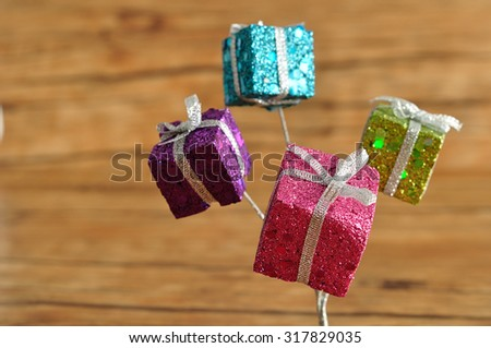 Little gifts in shinny wrapping for decorating a Christmas tree - stock photo