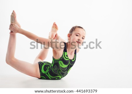 little girl acrobat. exercises. fitness - stock photo