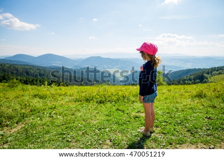 Little girl admiring views of the mountains