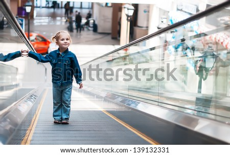 little girl alone on the track to move people