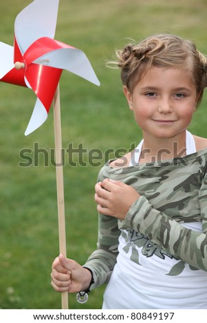 little girl and a paper windmill - stock photo