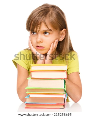 Little girl and a pile of books supporting her head with hands, isolated over white - stock photo