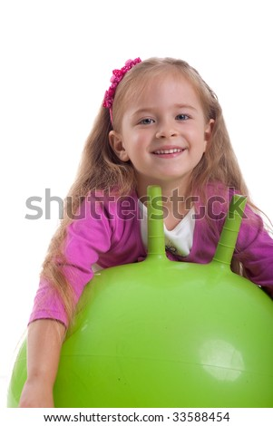 Little girl and big green ball on white background - stock photo