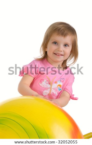 Little girl and big yellow ball on white background - stock photo
