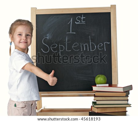 little girl and blackboard on white background - stock photo