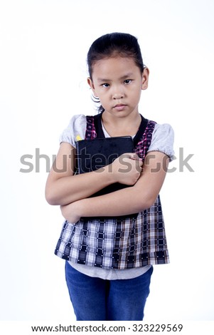 little girl and book isolated on a white background - stock photo