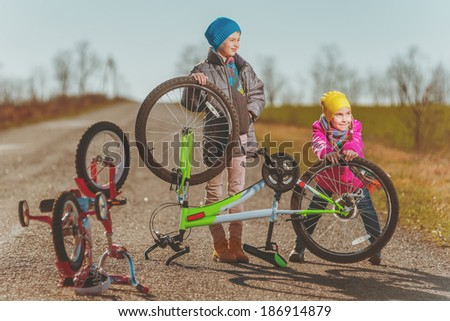 Little girl and boy have a fun outside - stock photo
