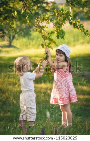 little girl and boy in the forest about mulberry tree