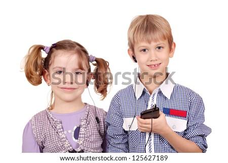 little girl and boy listening music on smart phone - stock photo