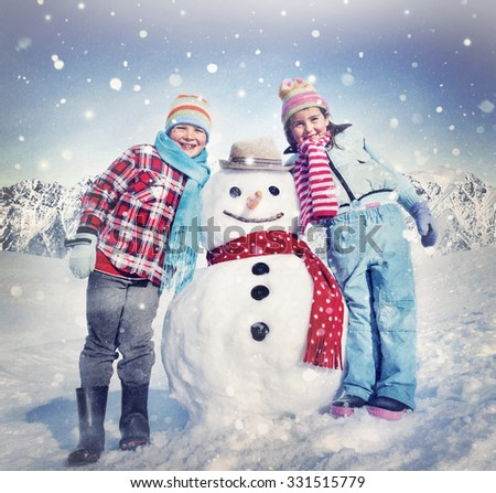 Little Girl and Boy Outdoors Winter Snowman Concept - stock photo