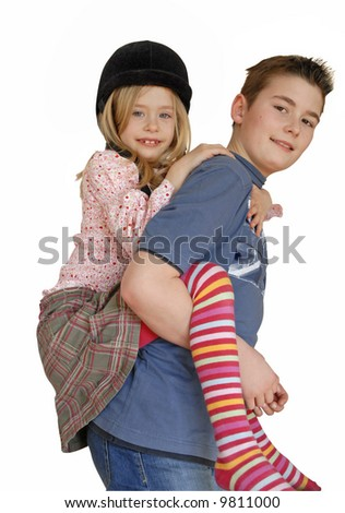 little girl and boy playing piggy-back