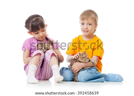 Little girl and boy playing with lovely scottish kittens isolated - stock photo
