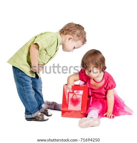 little girl and boy with gift