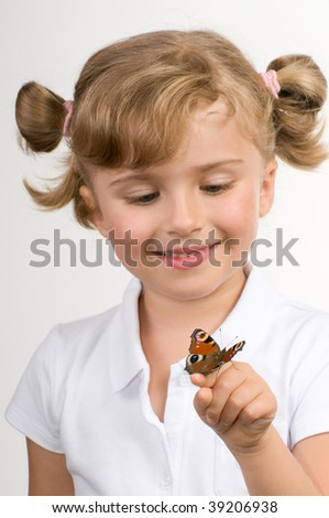 Little girl and butterfly - stock photo