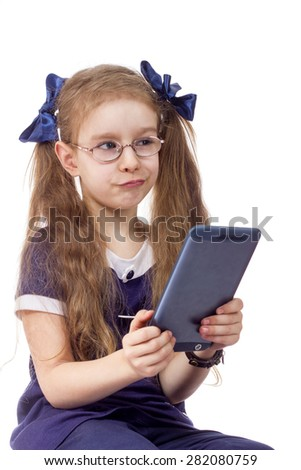 little girl and computer tablet isolated white background - stock photo
