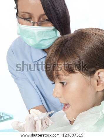 little girl and dentist - stock photo