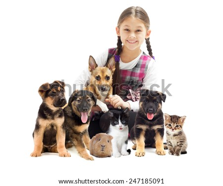little girl and dog and kitten and guinea pig - stock photo