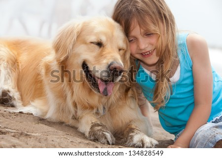 little girl and her dog - stock photo