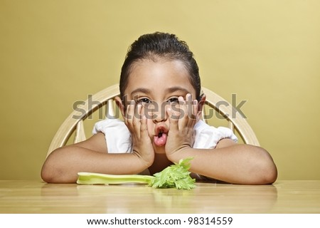 Little girl and her healthy snack - stock photo