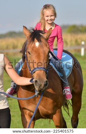 little girl and her horse