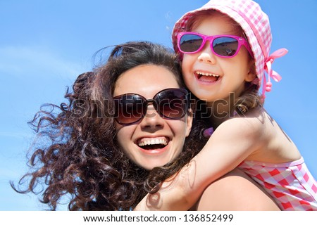little girl and her mother have  a good time at the seaside resort - stock photo