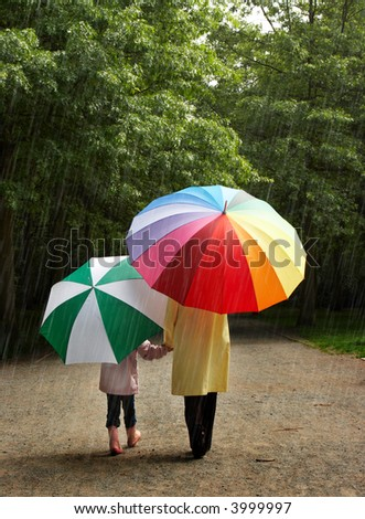 Little girl and her mother in the rain