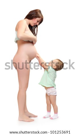 Little girl and her pregnant mother. Happy family concept. - stock photo