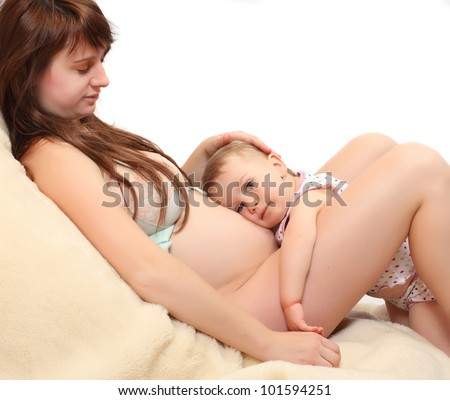 Little girl and her pregnant mother. Happy family concept.
