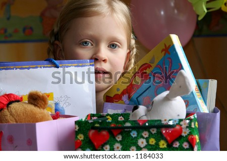 Little girl and her presents - stock photo
