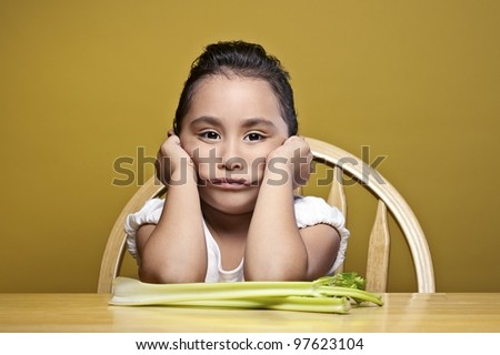 Little girl and her snack. - stock photo
