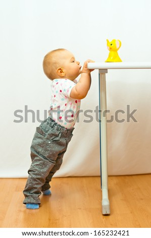 little girl and her toy - stock photo