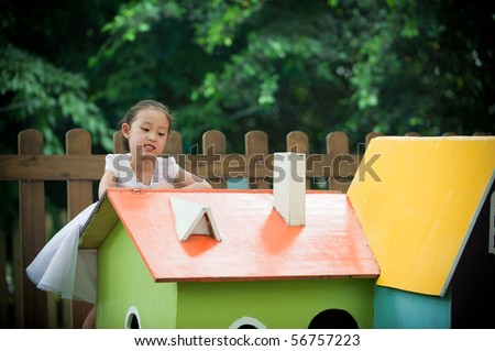 little girl and house like Fairy tale - stock photo