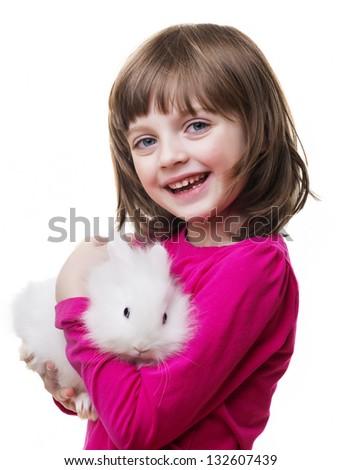 little girl and little white rabbit - stock photo