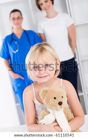 little girl and mother in doctor's office - stock photo