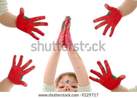 little girl and painted hands in all four corners of the screen - stock photo