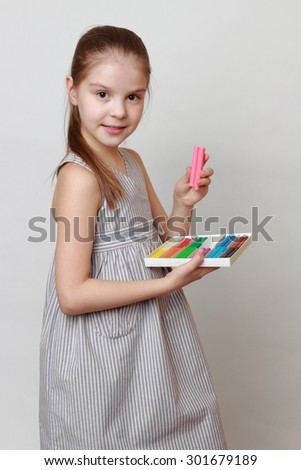 Little girl and plasticine