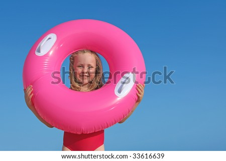 little girl and rubber ring - stock photo