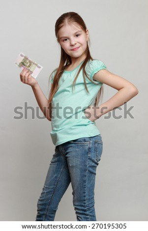 Little girl and russian money - stock photo