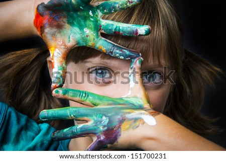 little girl and water colors - stock photo