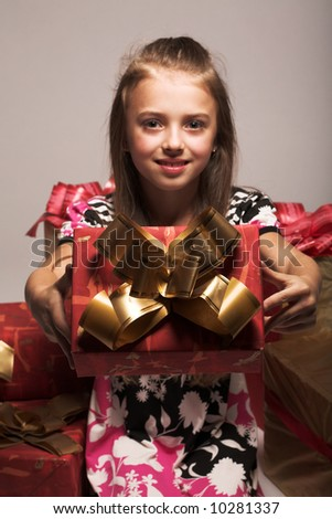 little girl and xmas presents - stock photo