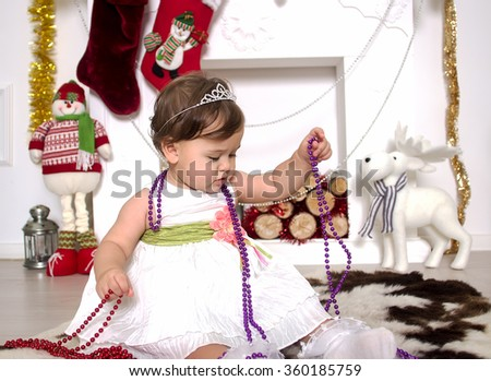 little girl around a Christmas fireplace
